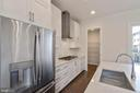 Bright white cabinetry and SS appliances - 23182 HAMPTON OAK TER, ASHBURN