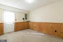 Lower level den with exit to backyard - 85 VISTA WOODS RD, STAFFORD