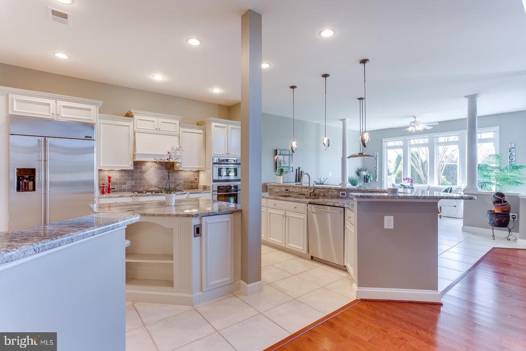 Two islands and granite counters in the kitchen - 18375 FAIRWAY OAKS SQ, LEESBURG