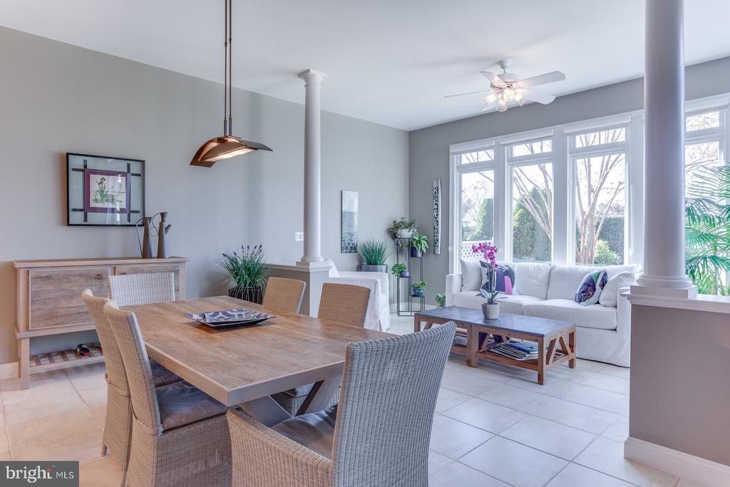 The breakfast room has views of the backyard. - 18375 FAIRWAY OAKS SQ, LEESBURG