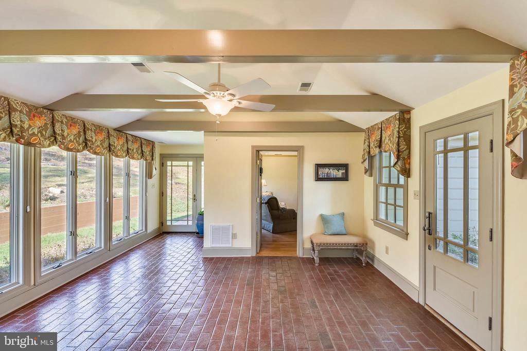 Sunroom with brick flooring - 669 APPLE PIE RIDGE RD, WINCHESTER