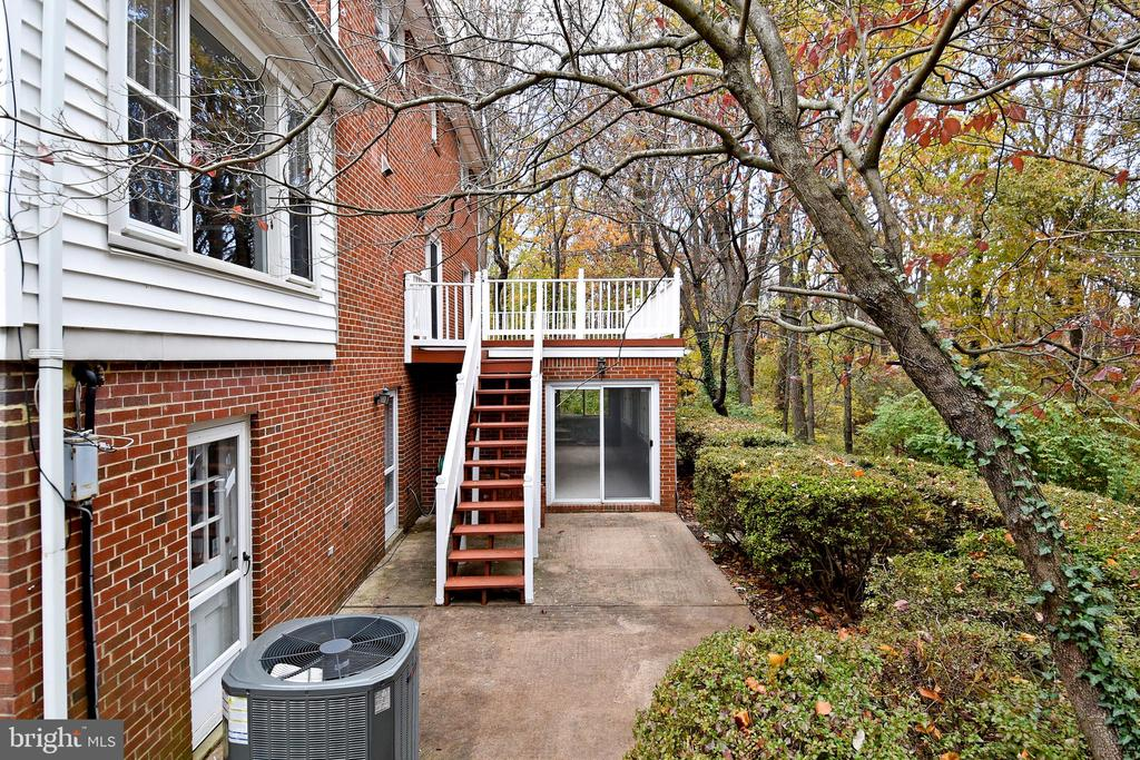 Deck has stairs down to cement patio. - 535 N LONGFELLOW ST, ARLINGTON