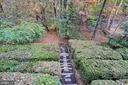 Terraced hedges and walkway to the woods. - 535 N LONGFELLOW ST, ARLINGTON