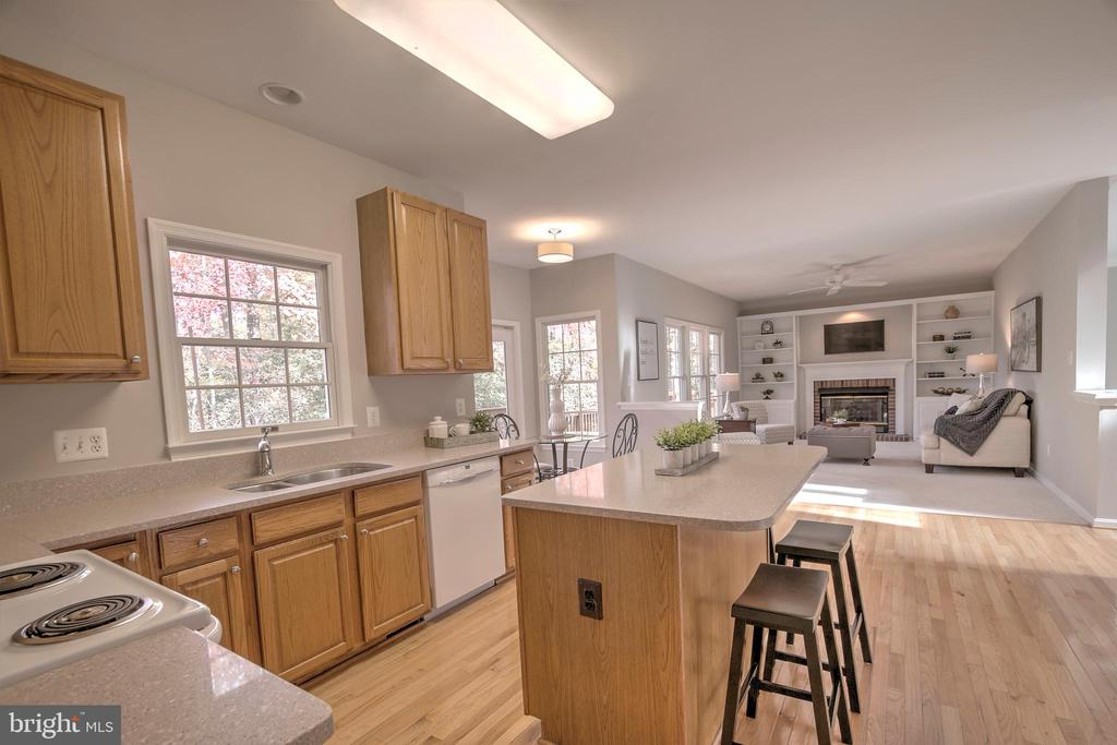 Kitchen open to Family Room - 12424 SILENT WOLF DR, MANASSAS