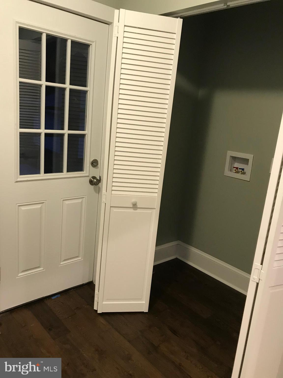 Laundry area and door to sun room