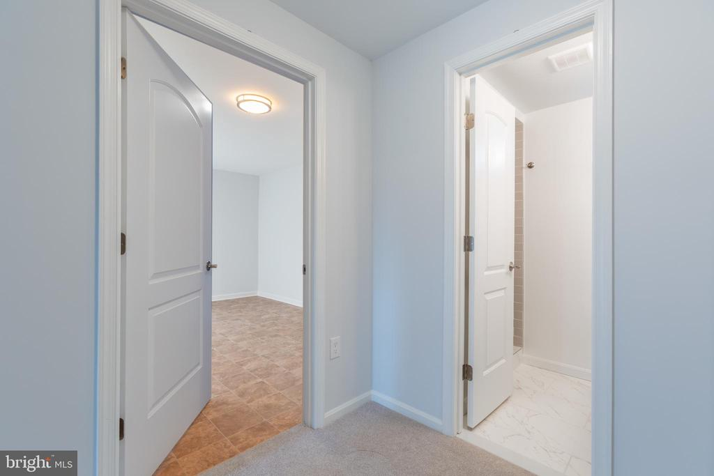 Basement - full bath and storage room - 8928 MAURICE LN, ANNANDALE