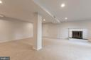 Basement family room & access to carport - 8928 MAURICE LN, ANNANDALE