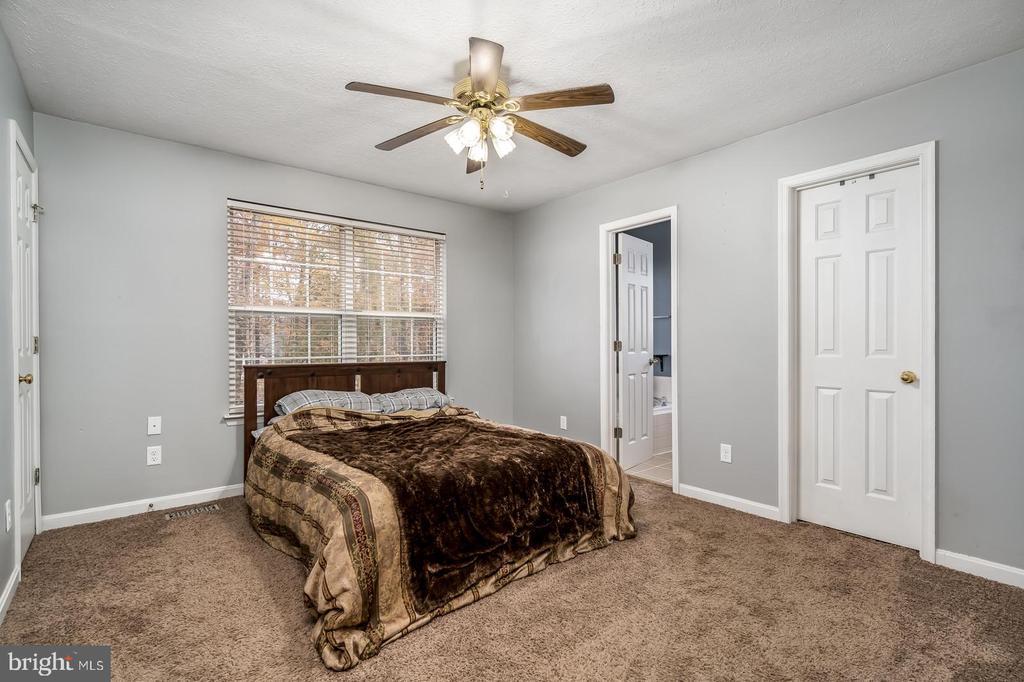 Main level master bedroom - 35486 WILDERNESS SHORES WAY, LOCUST GROVE