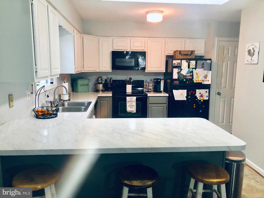 Have fun Cooking in this open spacious Kitchen! - 108 INDIAN HILLS RD, LOCUST GROVE