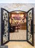 Elegant custom doors leading to wine room. - 11643 BLUE RIDGE LN, GREAT FALLS