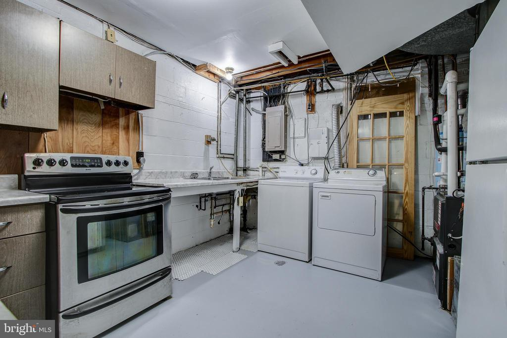 Lower level utility/laundry room with 2nd kitchen. - 6017 ELMENDORF DR, SUITLAND