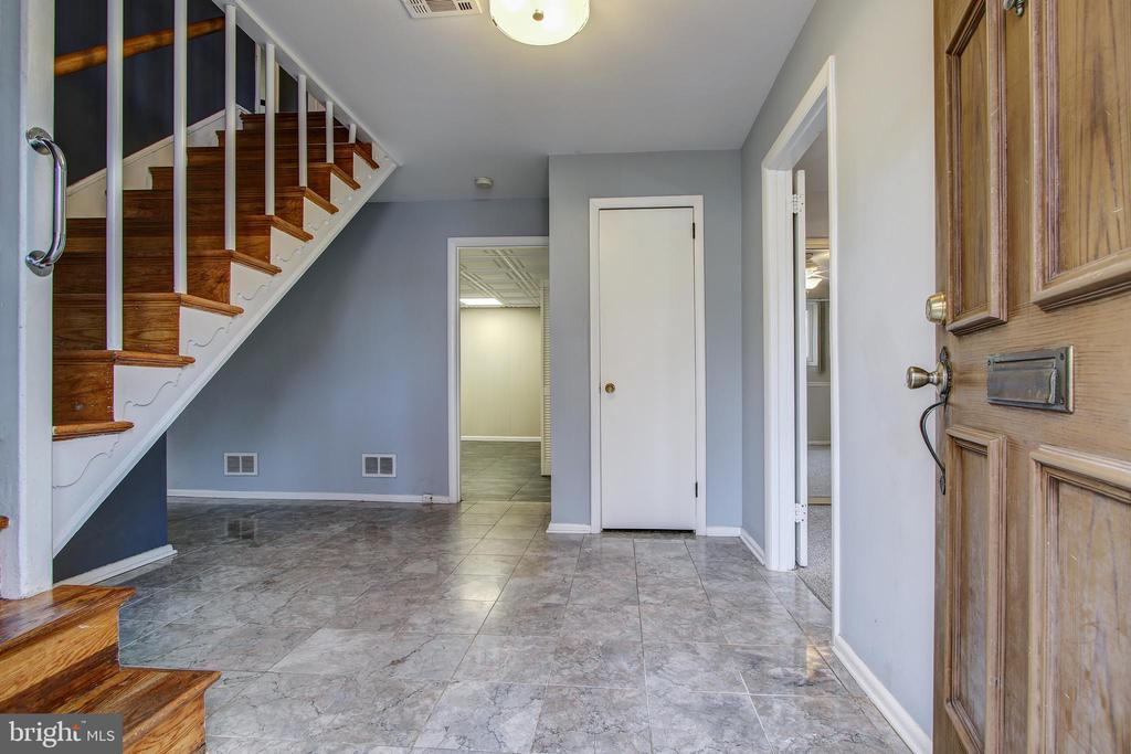 Entry foyer of lower level. - 6017 ELMENDORF DR, SUITLAND