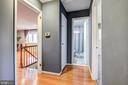 Hallway of main level leading to bedrooms. - 6017 ELMENDORF DR, SUITLAND