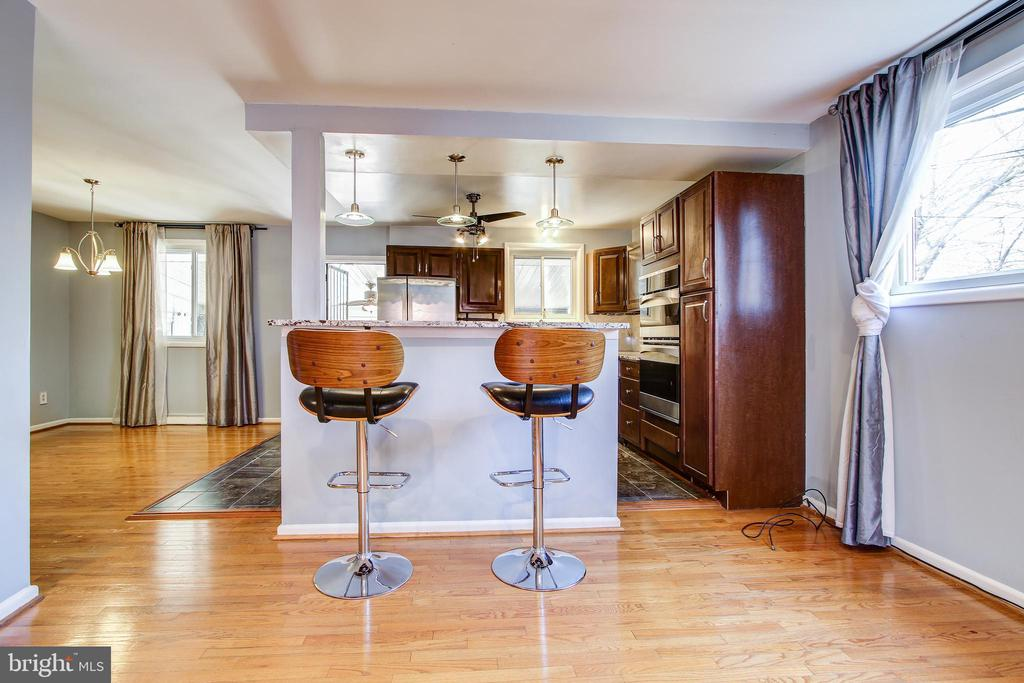 View of kitchen and breakfast bar. - 6017 ELMENDORF DR, SUITLAND