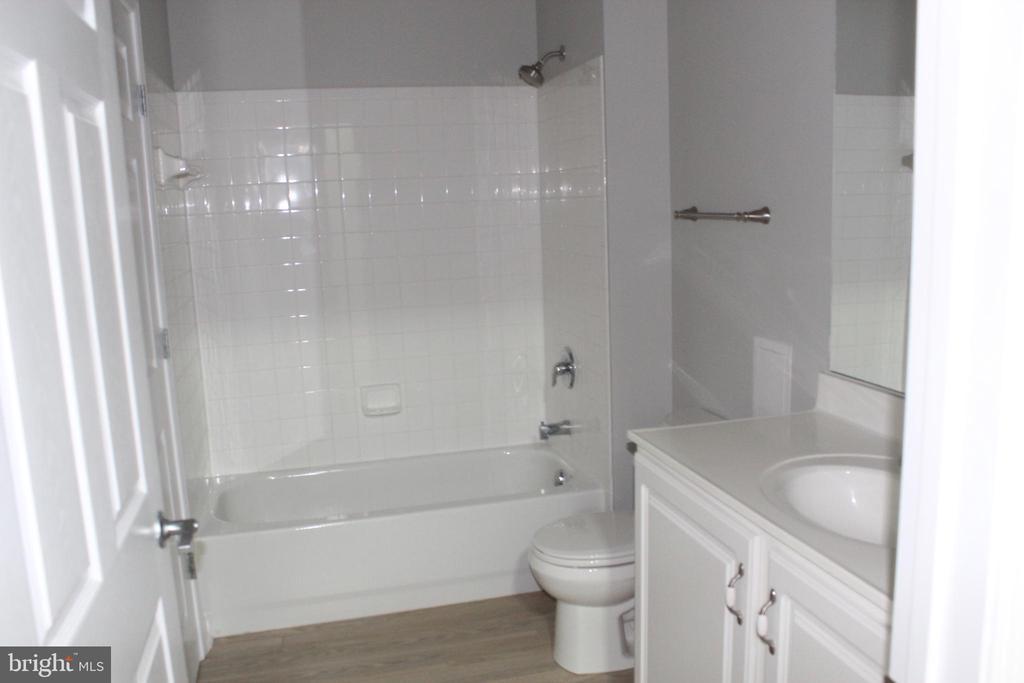Bathroom with tub - 42496 MAYFLOWER TER #101, BRAMBLETON