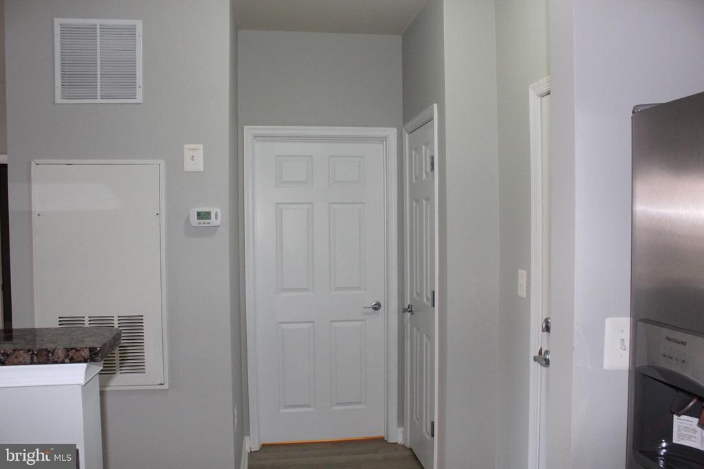 foyer across kitchen - 42496 MAYFLOWER TER #101, BRAMBLETON