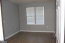 bedroom with plenty of lights - 42496 MAYFLOWER TER #101, BRAMBLETON