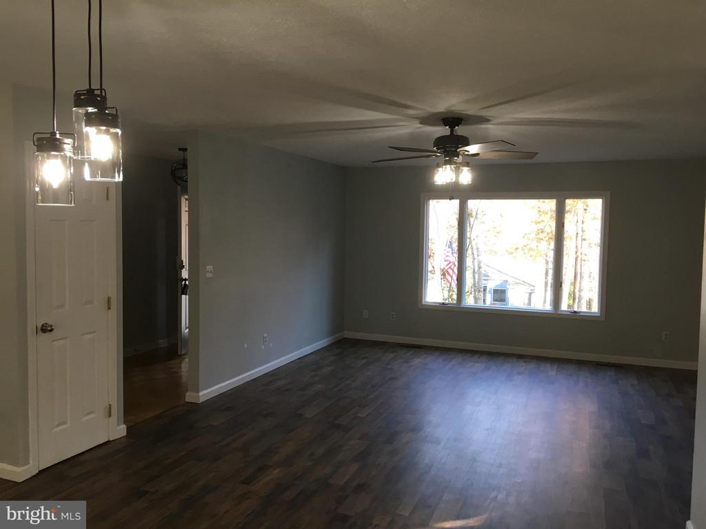Great lighting from large window in living room! - 108 INDIAN HILLS RD, LOCUST GROVE
