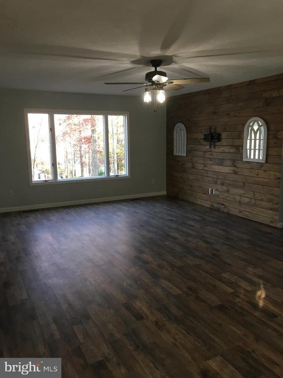Living rm w/ new floors and repurposed wooden wall - 108 INDIAN HILLS RD, LOCUST GROVE