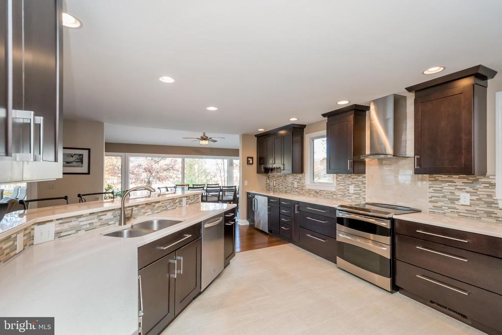 Kitchen opens to awesome dining area - 416 WILDERNESS DR, LOCUST GROVE