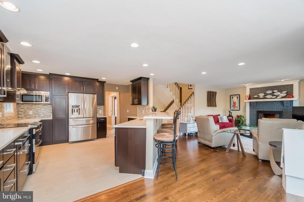 Open floor plan provides endless gathering spaces - 416 WILDERNESS DR, LOCUST GROVE