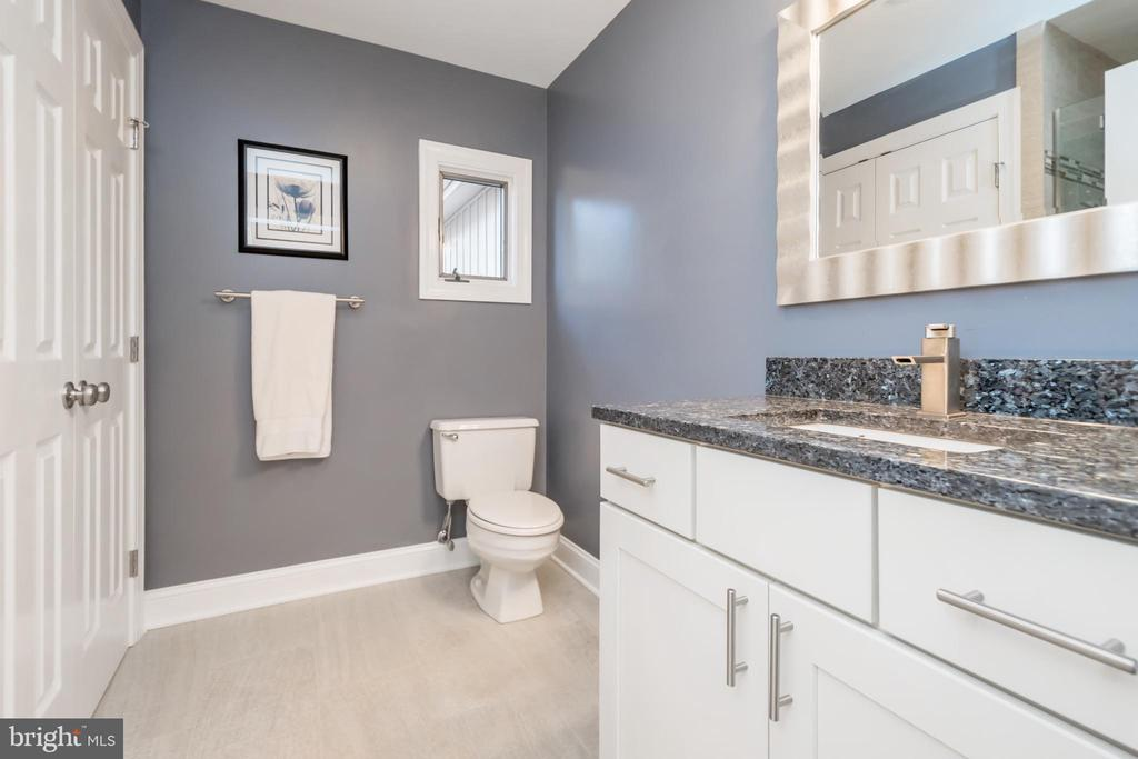 Main level  bath is sure to please - 416 WILDERNESS DR, LOCUST GROVE
