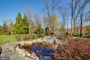 Koi pond with waterfall - 17066 WINNING COLORS PL, LEESBURG