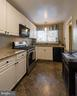 Kitchen w/ granite counter tops - 10655 WEYMOUTH ST #101, BETHESDA