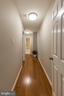 Hallway to bedrooms - 10655 WEYMOUTH ST #101, BETHESDA