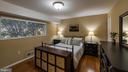 master bedroom with wood floors - 10655 WEYMOUTH ST #101, BETHESDA
