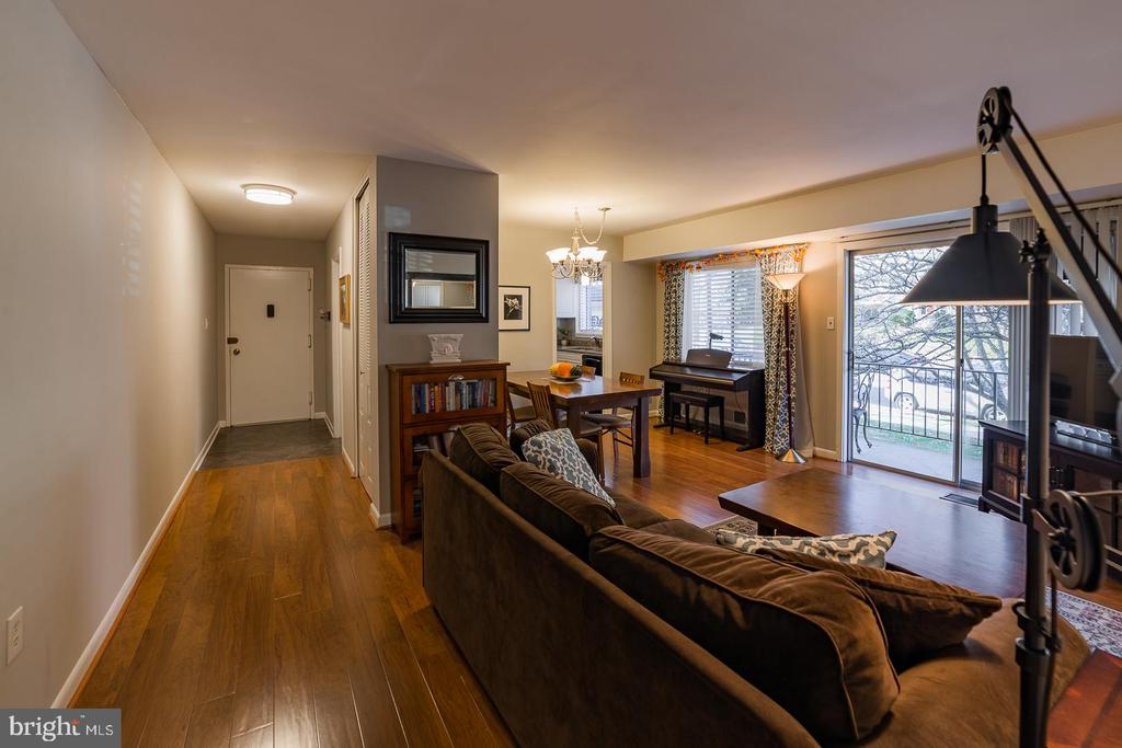Living room with beautiful laminate wood flooring - 10655 WEYMOUTH ST #101, BETHESDA