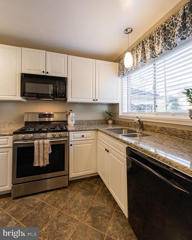 Kitchen with white cabinets - 10655 WEYMOUTH ST #101, BETHESDA