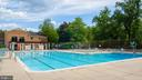 Relax and enjoy the spacious pool area - 10655 WEYMOUTH ST #101, BETHESDA