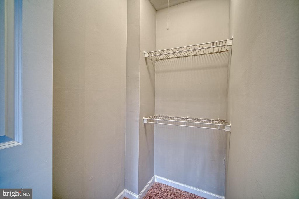 Bedroom 1 with racks - 10570 MAIN ST #520, FAIRFAX