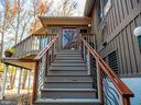 Custom stair with hand-carved oak tree entry door - 4610 FRIENDSHIP ACRES RD, NANJEMOY