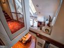 View from atop the spiral stair toward the kitchen - 4610 FRIENDSHIP ACRES RD, NANJEMOY