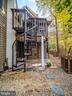 Spiral stair to lower outdoor shower - 4610 FRIENDSHIP ACRES RD, NANJEMOY