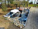 Sunken patio hot tub pergola w/ wisteria - 4610 FRIENDSHIP ACRES RD, NANJEMOY