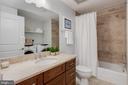 Guest Bath with Travertine tile - 1600 CLARENDON BLVD #W103, ARLINGTON