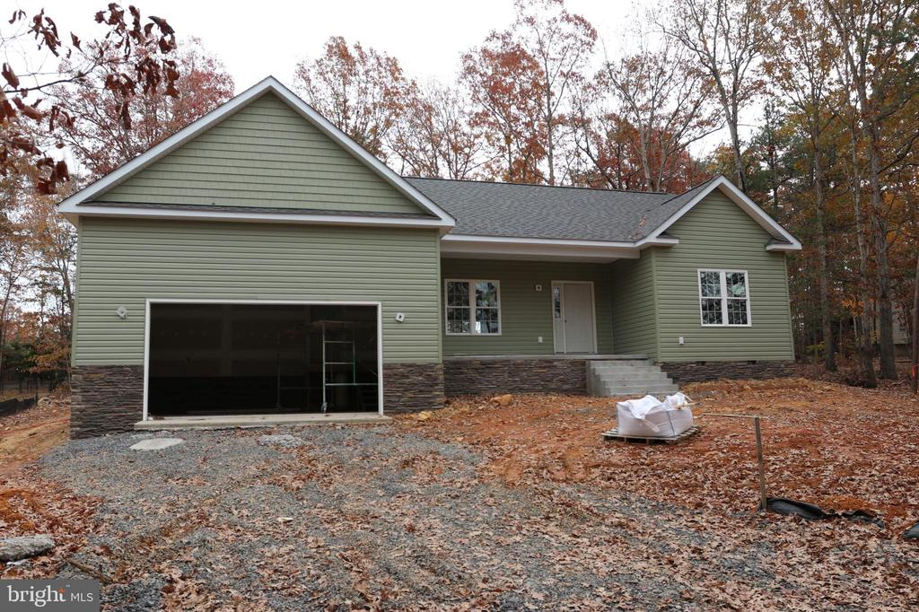 Exterior siding and stone work is almost complete - 1202 CONFEDERATE DR, LOCUST GROVE