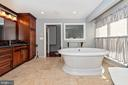 Master bathroom with custom cabinets. - 5302 IJAMSVILLE RD, IJAMSVILLE