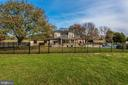 View of the rear of the home - fenced pool area. - 5302 IJAMSVILLE RD, IJAMSVILLE