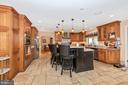 Grand custom kitchen. - 5302 IJAMSVILLE RD, IJAMSVILLE