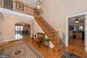 Entry foyer leading to upper level - chair lift. - 5302 IJAMSVILLE RD, IJAMSVILLE