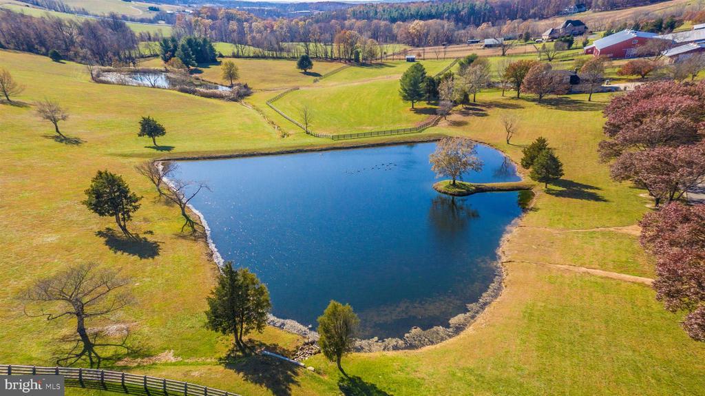 Aerial view of pond. - 5302 IJAMSVILLE RD, IJAMSVILLE