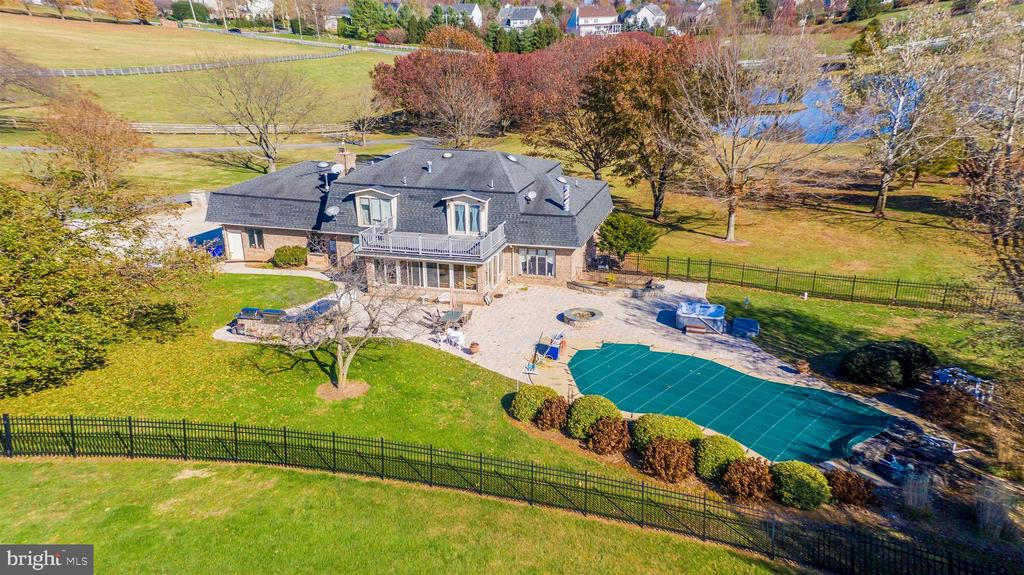 Aerial  view of backyard - large patio and pool. - 5302 IJAMSVILLE RD, IJAMSVILLE