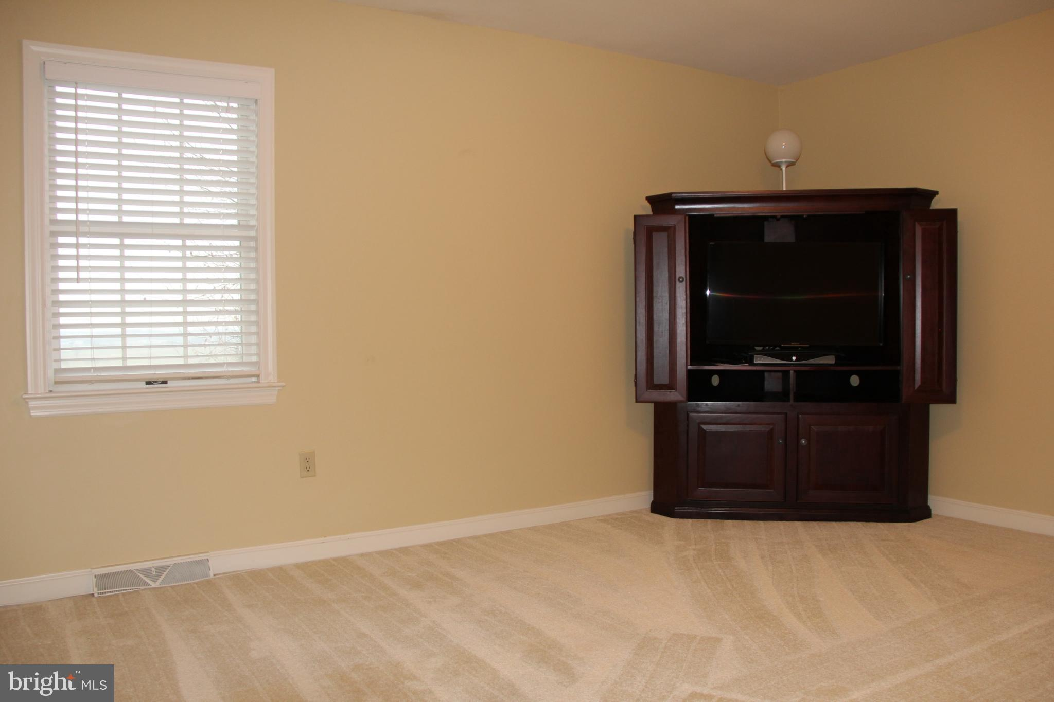 Upper Level Bedroom...TV included