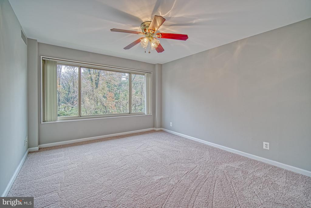 Master bedroom with wooded views. - 10570 MAIN ST #520, FAIRFAX