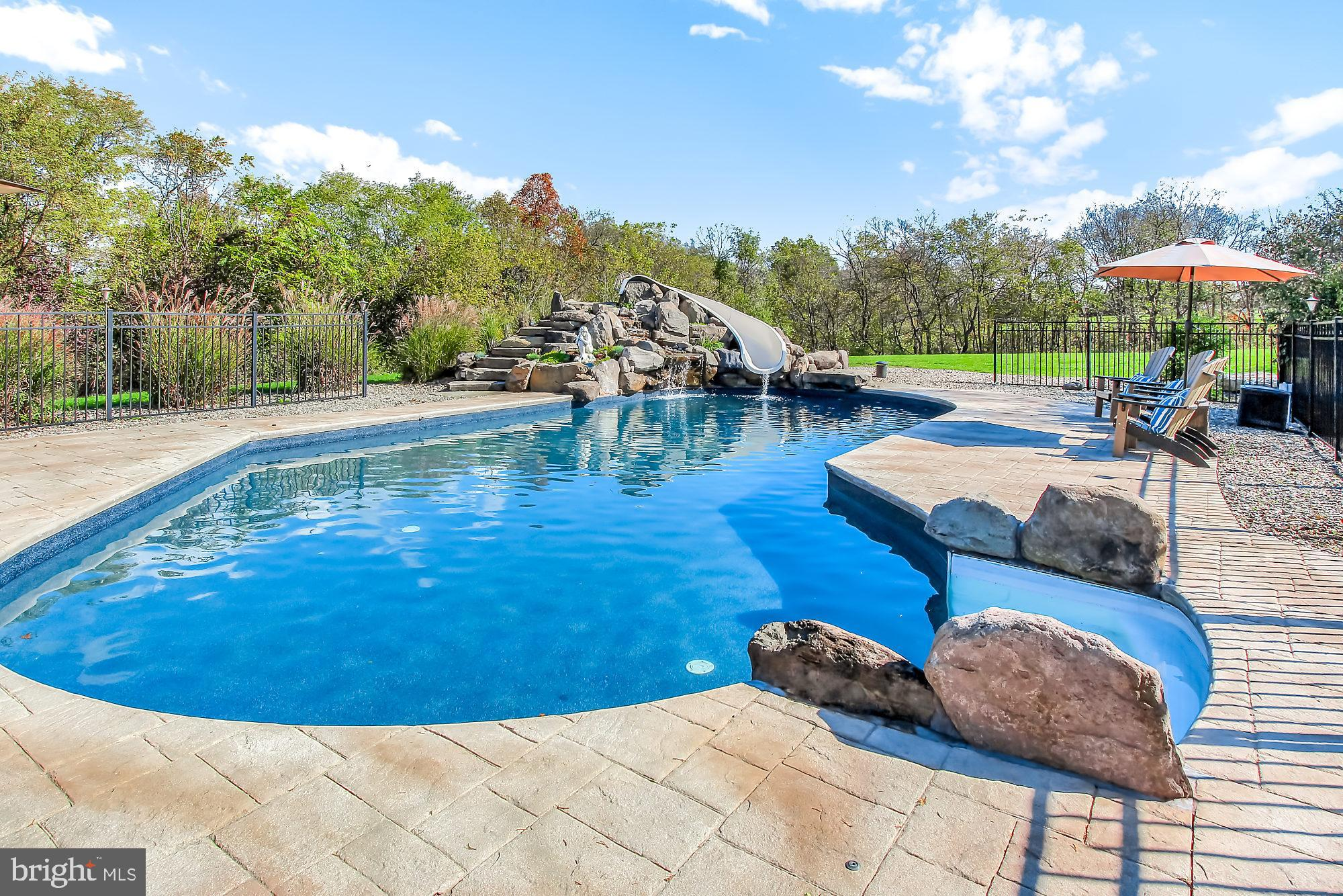 Your Grand Pool Offers Diving Rock, Slide and Wate