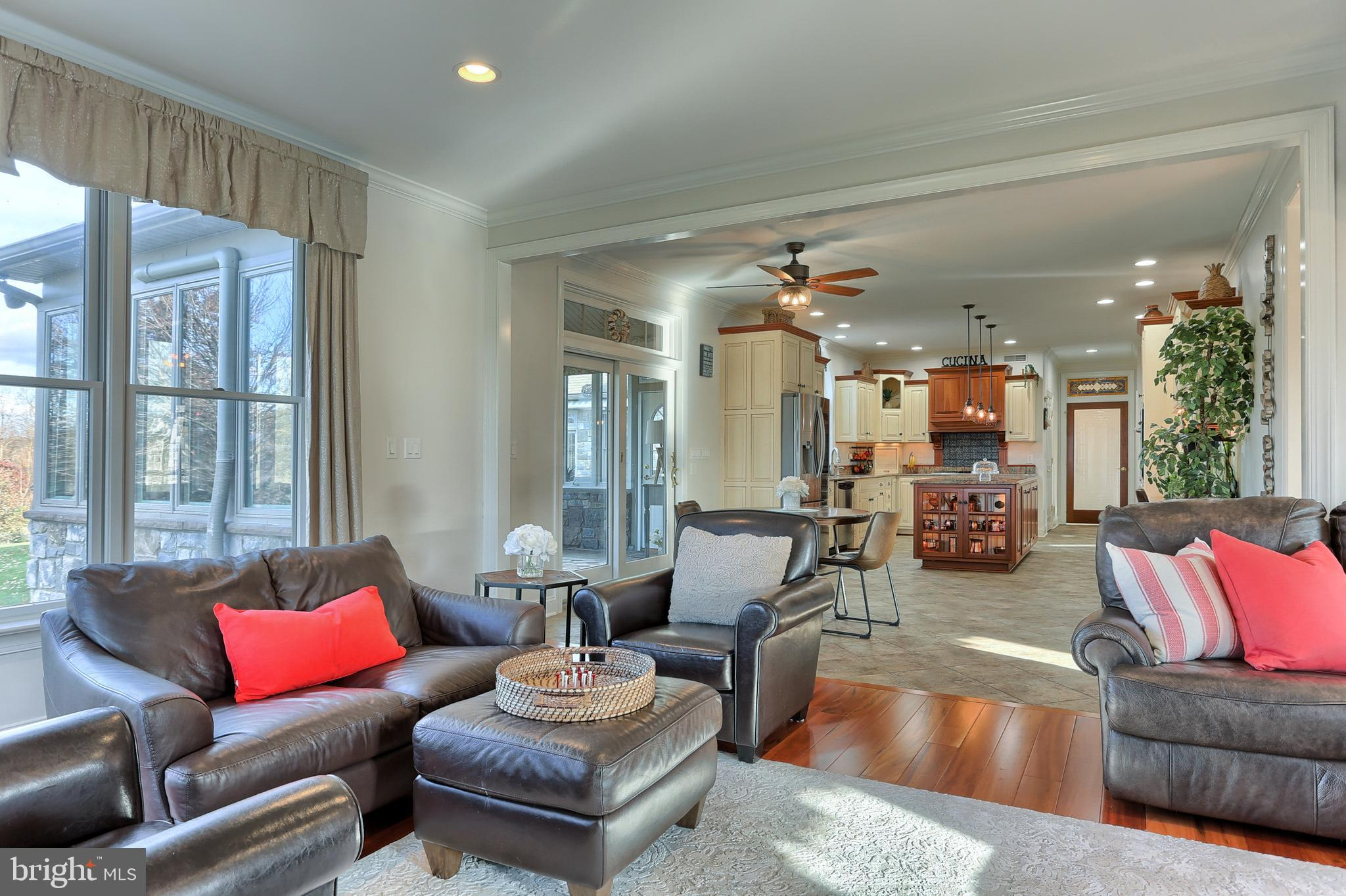 Family Room opens to Kitchen and Four Seasons Room